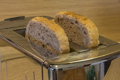 Slice bread ready to be toasted with toaster Stock Photo
