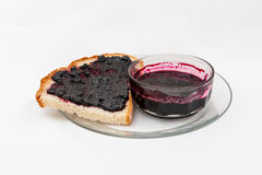 A slice of bread smeared with blueberry jam Royalty Free Stock Photography