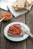 Slice of bread smeared with homemade chutney Stock Photography