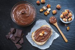Breakfast with chocolate spread in glass bowl Stock Photo