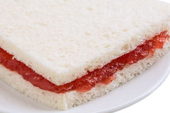 Slice of bread with strawberry jam. Close up Stock Photography