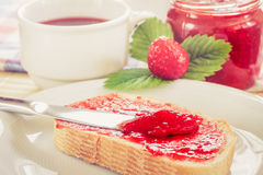 Slice of bread with strawberry jam Royalty Free Stock Image