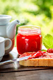Slice of bread with strawberry jam Royalty Free Stock Photography