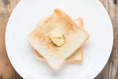 Slice of bread toast on a white plate. Royalty Free Stock Images
