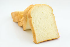 Slice of bread on white background Stock Photos