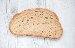 Slice of bread. Slice of white bread on table Stock Photos
