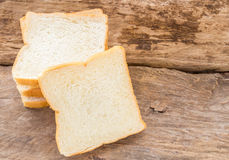 Slice of bread on wooden table background Royalty Free Stock Photography