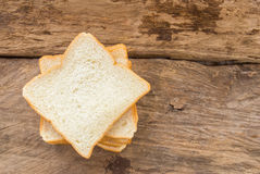 Slice of bread on wooden table background Stock Images