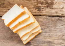 Slice of bread on wooden table background Royalty Free Stock Photos
