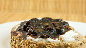 Slice of bread with yogurt and sour cherry jam, the perfect breakfast Royalty Free Stock Images