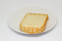 Slice of breads on the white disc isolate background Stock Photo