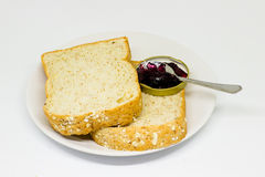 Slice of breads on the white disc isolate background Royalty Free Stock Photos