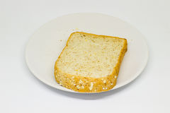 Slice of breads on the white disc isolate background Royalty Free Stock Image