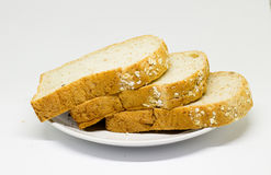 Slice of breads on the white disc isolate background Royalty Free Stock Images