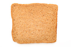 Slice of brown bread. Photograph of a slice of brown bread shot in studio on a white background Stock Photography