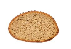 Slice of brown bread. Stock Photos