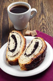 Slice bun with poppy and coffee Royalty Free Stock Photo