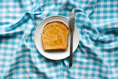 Slice of buttered toast on a plate Royalty Free Stock Images