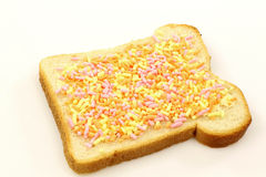 Slice of buttered white bread with colorful fruit Royalty Free Stock Photo