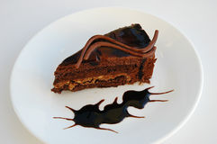 A slice of cake. Chocolate cake with peanut butter, and caramel Stock Photos