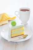 Slice cake. Saffron sponge cake with cream green tea, slice on a plate, selective focus Stock Images