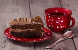 Slice of cake. With tea Royalty Free Stock Photos