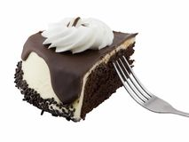 Slice of cake. Slice of chocolate cream cheese cake with fork isolated on white Stock Photo