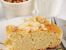 Slice of cake with almonds and apples Royalty Free Stock Photo