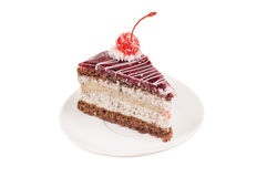 Slice of cake with cherry Royalty Free Stock Images
