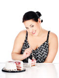 Slice of cake and chubby woman. Chubby woman eating slice of cake, isolated on white stock photos