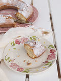 Slice of cake `Ciambellone` with crumbs on ceramic plate painted with floral motifs Royalty Free Stock Photo
