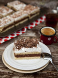 Slice of cake. With cocoa cream Royalty Free Stock Images