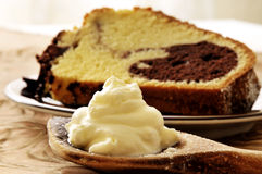 Slice of cake with cream  Royalty Free Stock Images