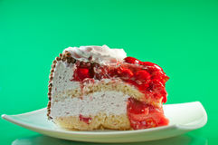 Slice of cake with cream and berries Stock Images