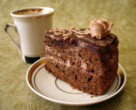 Slice of cake and cup. Slice of chocolate cake on plate and cup Stock Photo