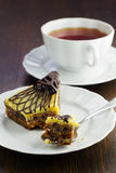 A slice of cake with a cup of tea Royalty Free Stock Photo