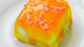 Slice of cake with orange jam. stock video