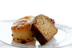 Slice of cake and scones Stock Images