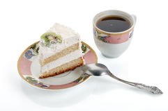 Slice cake on small plate with spoon and coffee cup isolated on white. Path included Royalty Free Stock Photos