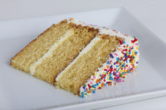 A slice of cake with sprinkles Royalty Free Stock Image