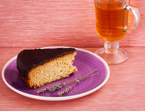Slice of cake with tea. Slice of cake on the plate with tea Royalty Free Stock Image