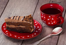 Slice of cake with tea. On the table Royalty Free Stock Photography