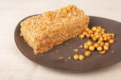 Slice of caramel nut cream cake Royalty Free Stock Photo