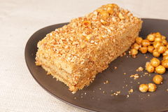 Slice of caramel nut cream cake Stock Photos