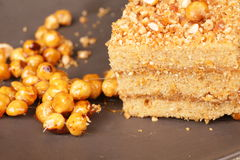 Slice of caramel nut cream cake stock images