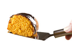 Slice of carrot cake with chocolate on white background Stock Photo