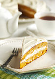 Slice of carrot cake with cream cheese frosting Royalty Free Stock Photos