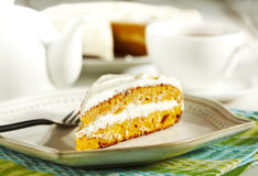 Slice of carrot cake with cream cheese frosting Royalty Free Stock Image