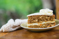 Slice of carrot cake on dish. Stock Images