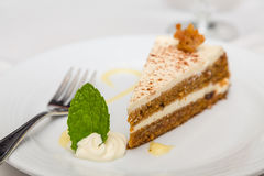 Slice of Carrot Cake with Fork and Mint Leaf Stock Image